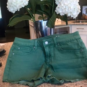 Cutoff green shorts